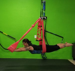 Photo of Kim in an Aerial Yoga Pose