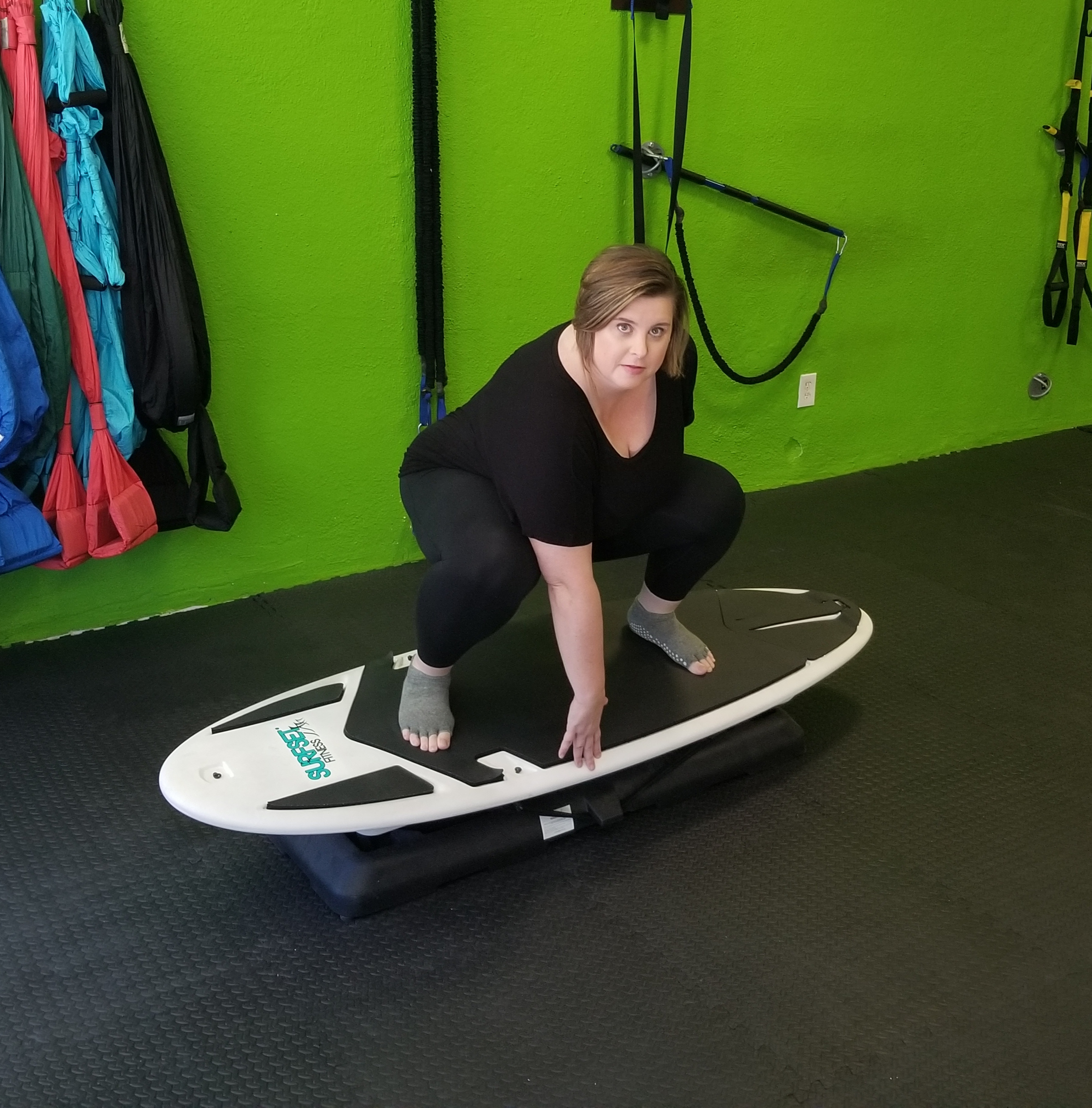 Photo of Tracie Thompson demonstrating a Surfset Squat