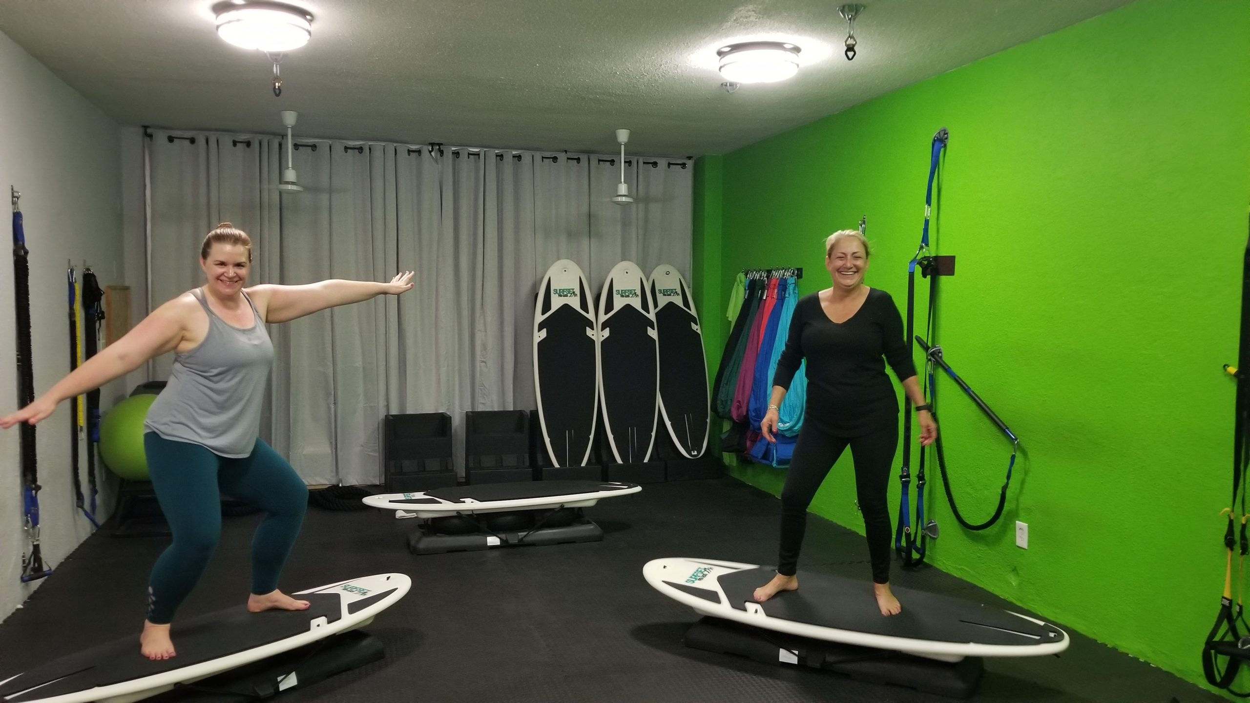 Two of our clients standing on Surfset Boards